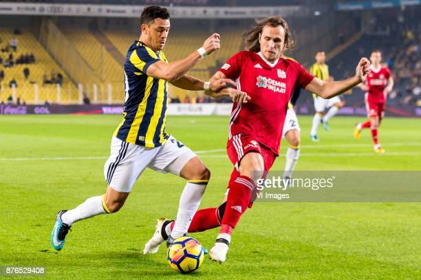 Giuliano Victor de Paula of Fenerbahce SK Vitaly Dyakov of Demir Grup Sivasspor during the Turkish Spor Toto Super Lig football match between...