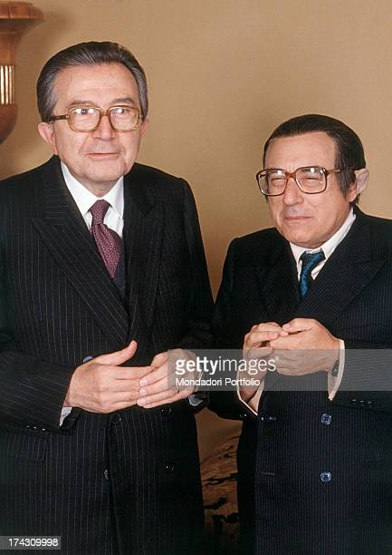 Giulio Andreotti Italian Foreign Minister smiling alongside Italian actor Oreste Lionello in his shoes Italy 1988