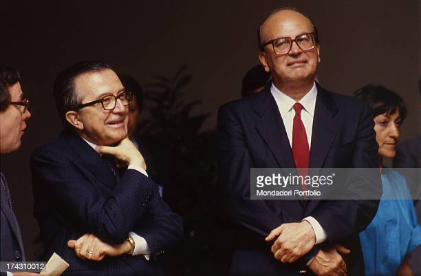 Giulio Andreotti leader of the Christian Democratic Party is smiling next to Bettino Craxi head of the Italian Socialist Party Italy 1980