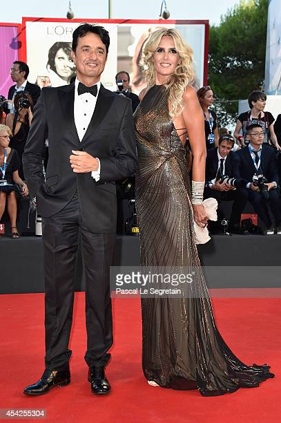 Giulio Base and Tiziana Rocca attend the Opening Ceremony and 'Birdman' premiere during the 71st Venice Film Festival on August 27 2014 in Venice...