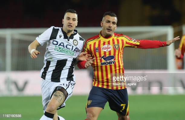 Giulio Donati of Lecce competes for the ball with Ilija Nestorovsky of Udinese during the Serie A match between US Lecce and Udinese Calcio at Stadio...