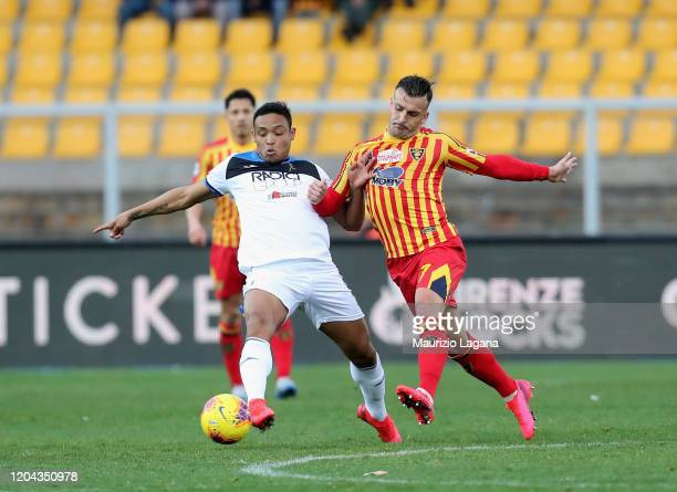 Giulio Donati of Lecce competes for the ball with Luis Muriel of Atalanta during the Serie A match between US Lecce and Atalanta BC at Stadio Via del...