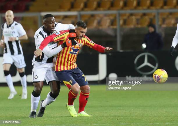 Giulio Donati of Lecce competes for the ball with Stefano Okaka of Udinese during the Serie A match between US Lecce and Udinese Calcio at Stadio Via...