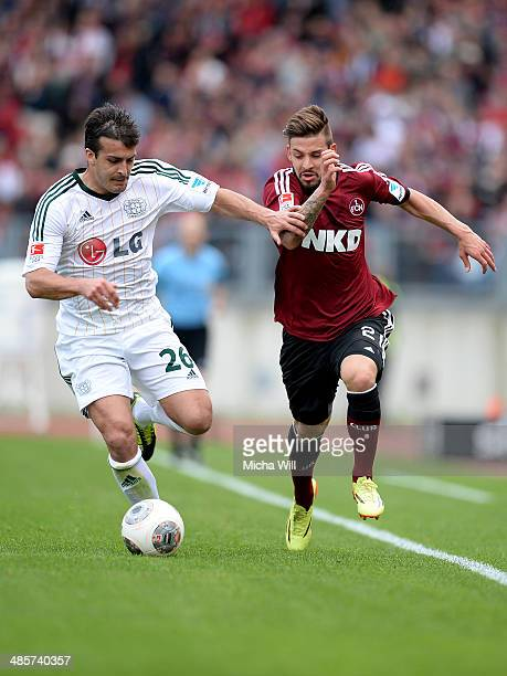 Giulio Donati of Leverkusen and Marvin Plattenhardt of Nuernberg tussle for the ball during the Bundesliga match between 1 FC Nuernberg and Bayer...