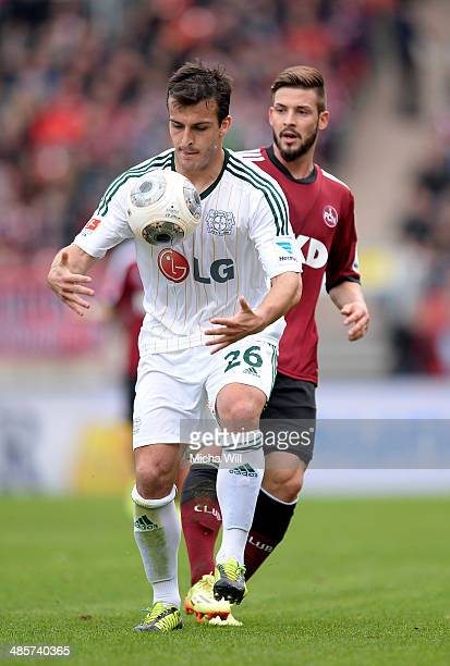 Giulio Donati of Leverkusen and Marvin Plattenhardt of Nuernberg compete for the ball during the Bundesliga match between 1 FC Nuernberg and Bayer...