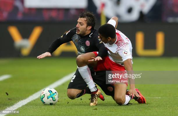 Giulio Donati of Mainz battles for the ball with Fernandes da Silva of Leipzig during the Bundesliga match between RB Leipzig and 1FSV Mainz 05 at...