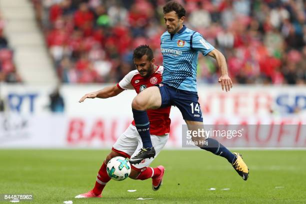 Giulio Donati of Mainz fights for the ball with Admir Mehmedi of Bayer Leverkusen during the Bundesliga match between 1 FSV Mainz 05 and Bayer 04...