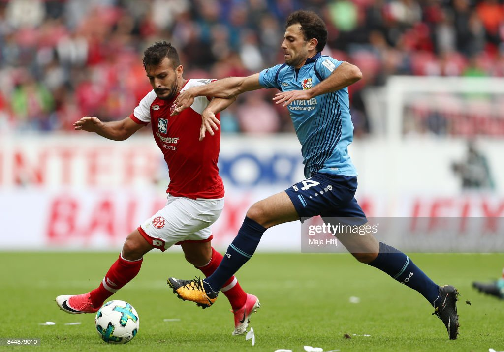 Giulio Donati of Mainz (l) fights for the ball with Admir Mehmedi of Bayer Leverkusen during the Bundesliga match between 1. FSV Mainz 05 and Bayer 04 Leverkusen at Opel Arena on September 9, 2017 in Mainz, Germany.