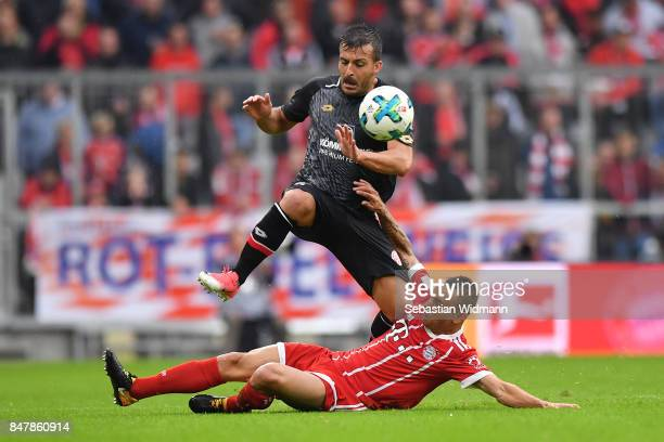 Giulio Donati of Mainz fights for the ball with Rafinha of Bayern Muenchen during the Bundesliga match between FC Bayern Muenchen and 1 FSV Mainz 05...