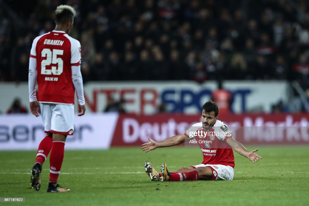 Giulio Donati (R) of Mainz reacts next to Jean-Philippe Gbamin of Mainz during the Bundesliga match between 1. FSV Mainz 05 and Eintracht Frankfurt at Opel Arena on October 27, 2017 in Mainz, Germany.