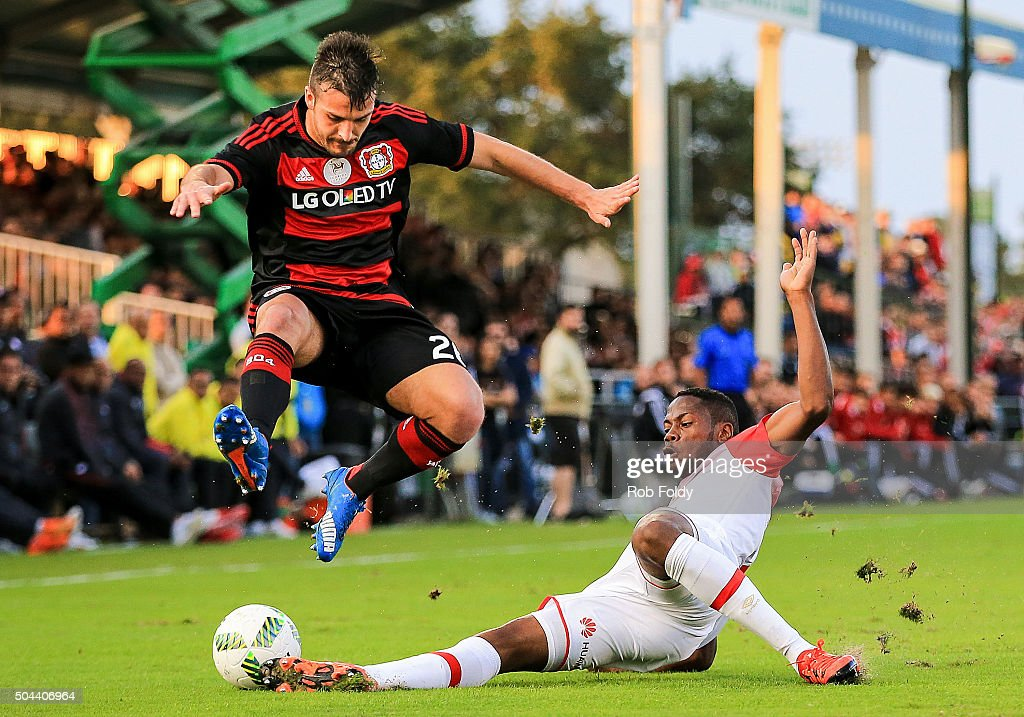 Giulio Donati #26 of the Bayer Leverkusen jumps over Armando Vargas #7 of the Indepediente Santa Fe during the match at the ESPN Wide World of Sports Complex on January 10, 2016 in Kissimmee, Florida.