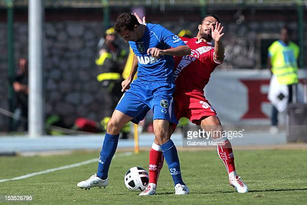 Giulio Donati of US Grosseto battles for the ball with Alessandro Longhi of US Sassuolo during the Serie B match between US Grosseto FC and US...