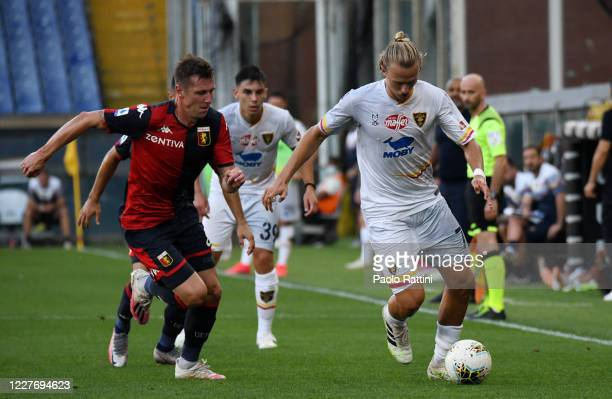 Giulio Donati of US Lecce battle for the ball with Lukas Lerager of Genoa CFC during the Serie A match between Genoa CFC and US Lecce at Stadio Luigi...