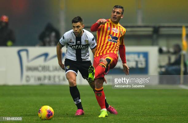 Giulio Donati of US Lecce competes for the ball with Alberto Grassi of Parma Calcio during the Serie A match between Parma Calcio and US Lecce at...