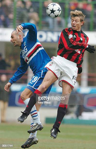 Giulio Falcone and Jon Dahl Tomasson clash during the Serie A match between AC Milan and Sampdoria on March 7 in Milan Italy