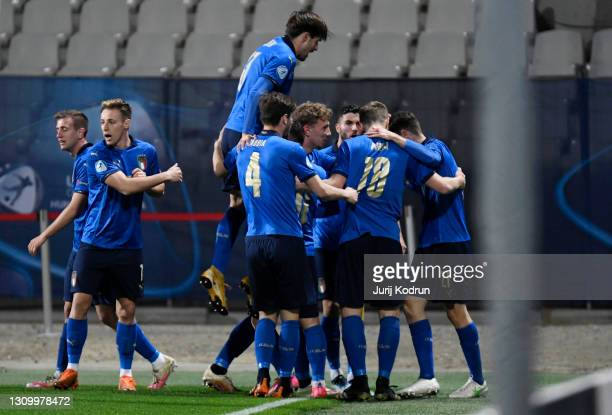 Giulio Maggiore of Italy celebrates with team mates after scoring their side's first goal during the 2021 UEFA European Under-21 Championship Group B...