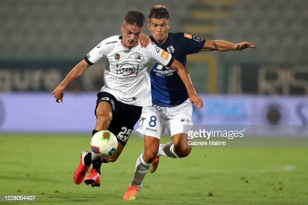 Giulio Magiore of ASC Spezia battles for the ball with Jacopo Segre of Chievo Verona during the Serie B Playoffs match between ASC Spezia and Chievo...