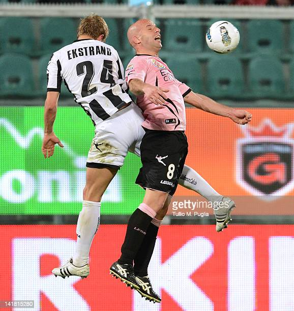 Giulio Migliaccio of Palermo and Joel Ekstrand of Udinese jump for the ball during the Serie A match between US Citta di Palermo and Udinese Calcio...