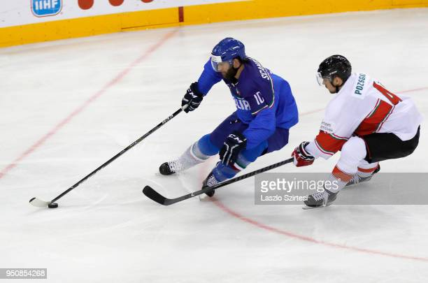 Giulio Scandella of Italy leaves Tamas Pozsgai of Hungary behind during the 2018 IIHF Ice Hockey World Championship Division I Group A match between...