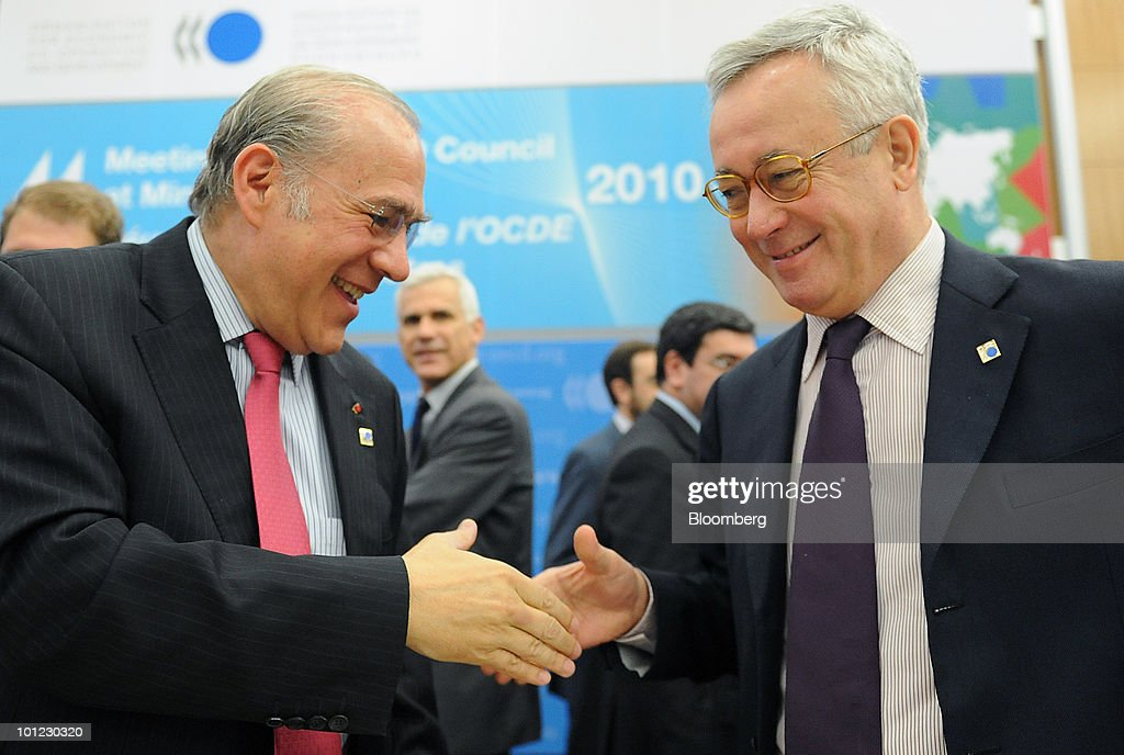 Giulio Tremonti, Italy's finance minister, right, shakes hands with Angel Gurria, secretary-general of the Organisation of Economic Cooperation and Development (OECD), at the group's conference in Paris, France, on Friday, May 28, 2010. Slovenia, along with Israel and Estonia, are joining the Paris-based organization of 31 of the world's most developed economies. Photographer: Antoine Antoniol/Bloomberg via Getty Images