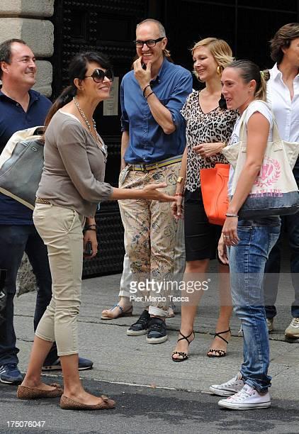 Giulio Violati, Maria Grazia Cucinotta, Regina Baresi and Maria Grazia Severi are sighted in via Montenapoleone on July 29, 2013 in Milan, Italy.