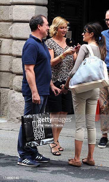 Giulio Violati, Maria Grazia Severi and Maria Grazia Cucinotta are sightinged in via Montenapoleone on July 29, 2013 in Milan, Italy.