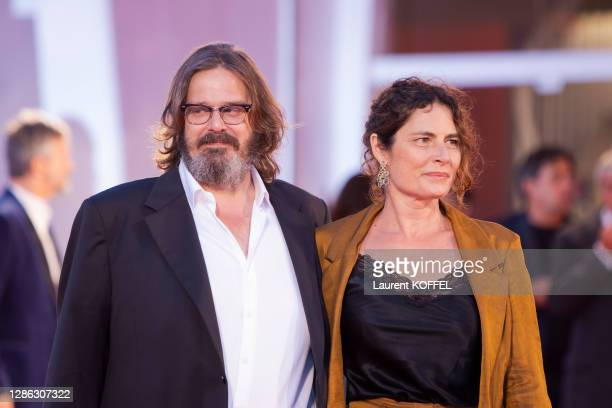 """Giuseppe Battiston and guest walk the red carpet ahead of the movie """"The World To Come"""" at the 77th Venice Film Festival on September 06, 2020 in..."""