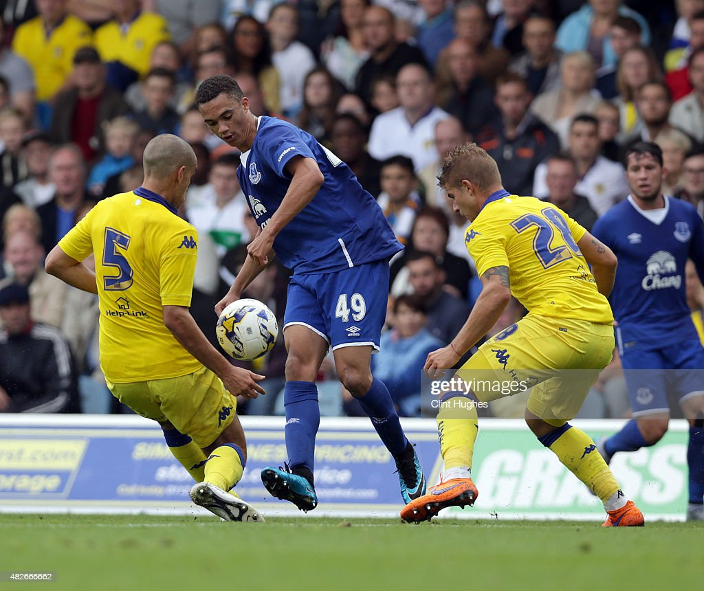 Giuseppe Bellusci (L) and Gaetano Berardi tackle Antonee Robinson of Everton during the Pre Season Friendly match between Leeds United and Everton at Elland Road on August 1, 2015 in Leeds, England.