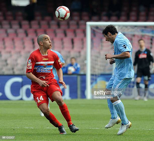Giuseppe Bellusci of Catania and Ezequiel Lavezzi of Napoli in action during the Serie A match between SSC Napoli and Catania Calcio at Stadio San...