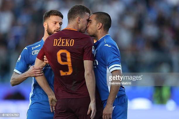 Giuseppe Bellusci of Empoli FC and Edin Dzeko of AS Roma during the Serie A match between Empoli FC and AS Roma at Stadio Carlo Castellani on October...