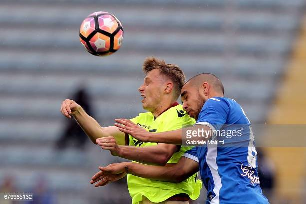 Giuseppe Bellusci of Empoli FC battles for the ball with Ladislav Kreici of Bologna FC during the Serie A match between Empoli FC and Bologna FC at...