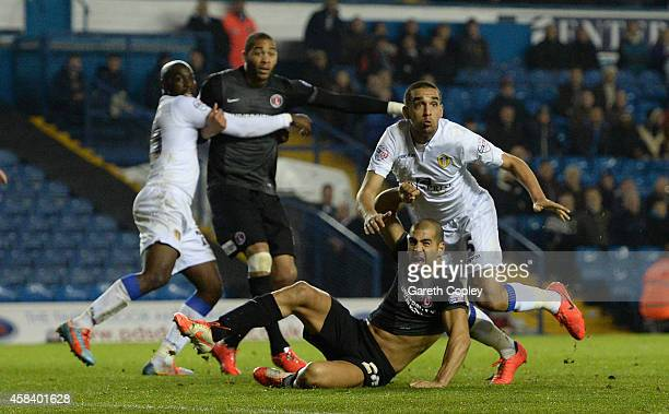 Giuseppe Bellusci of Leeds United pulls down Tal Ben Haim of Charlton Athletic to conceed a penalty during the Sky Bet Championship match between...