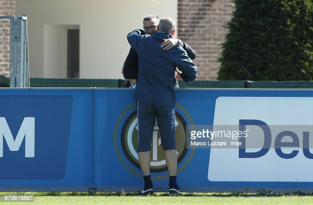 Giuseppe Bergomi embraces FC Internazionale Milano coach Stefano Pioli during the FC Internazionale training session at the club's training ground...