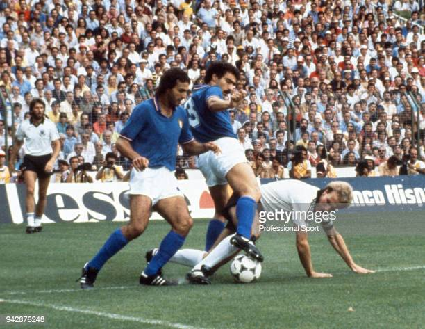 Giuseppe Bergomi of Italy and Antonio Cabrini tackle KarlHeinz Rummenigge of West Germany during the FIFA World Cup Final at the Bernabéu Stadium on...