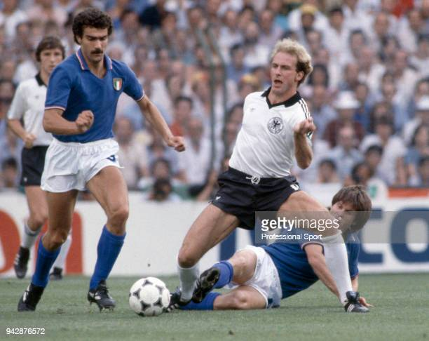 Giuseppe Bergomi of Italy battles for the ball with KarlHeinz Rummenigge of West Germany during the FIFA World Cup Final at the Bernabéu Stadium on...