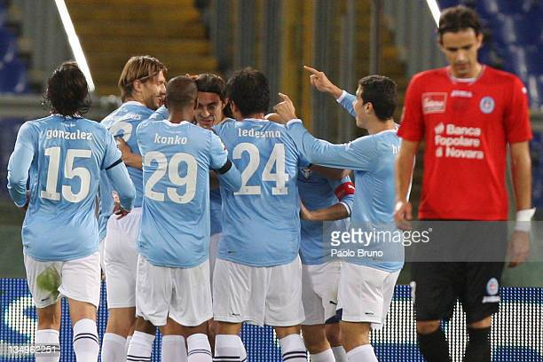 Giuseppe Biava of SS Lazio celebrates with teammates after scoring the opening goal during the Serie A match between SS Lazio and Novara Calcio at...