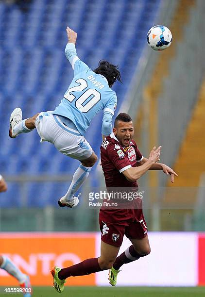 Giuseppe Biava of SS Lazio competes for the ball with Omar El Kaddouri of Torino FC during the Serie A match between SS Lazio and Torino FC at Stadio...