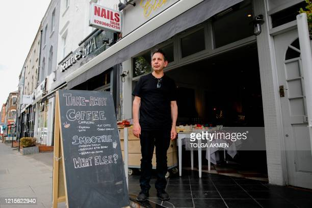 Giuseppe Calcagno, owner of Ciullosteria, an Italian restaurant turned delicatessen specialising in Italian products, poses outside his shop in...