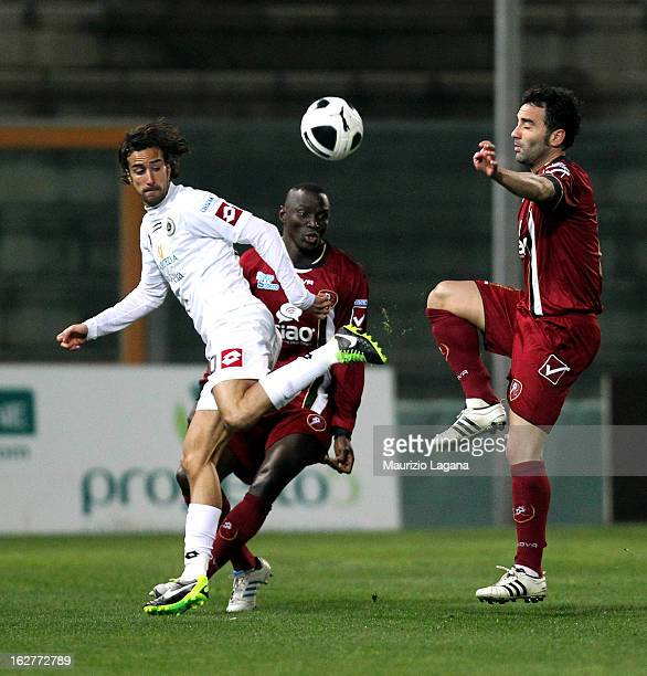 Giuseppe Colucci of Reggina competes for the ball with Davide Di Gennaro of Spezia during the Serie B match between Reggina Calcio and AC Spezia at...