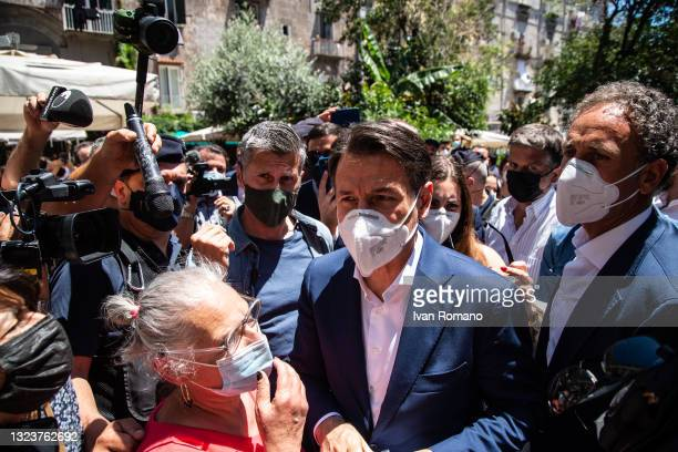 Giuseppe Conte in the crowd and journalists on June 15, 2021 in Naples, Italy. The political head of the 5 Star Movement and former Prime Minister...