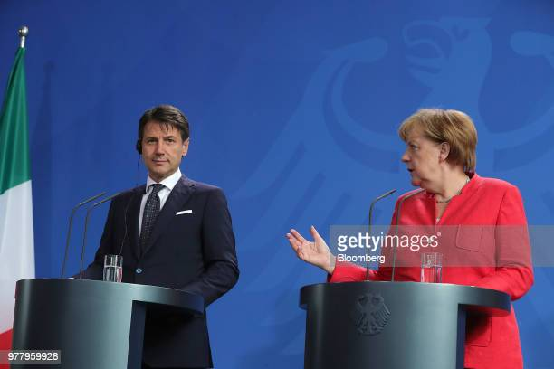 Giuseppe Conte Italy's prime minister left and Angela Merkel Germany's chancellor walk to a press conference at the Chancellery building in Berlin...