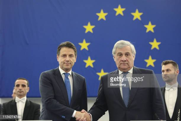 Giuseppe Conte Italy's prime minister left and Antonio Tajani president of the European Parliament shake hands during a 'Future of Europe' plenary...