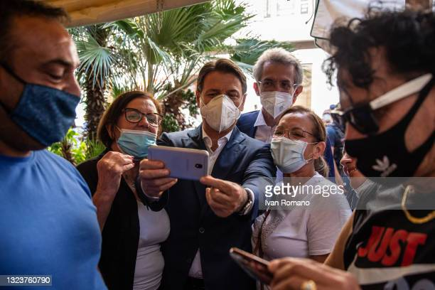 Giuseppe Conte poses for selfies on June 15, 2021 in Naples, Italy. The political head of the 5 Star Movement and former Prime Minister Giuseppe...
