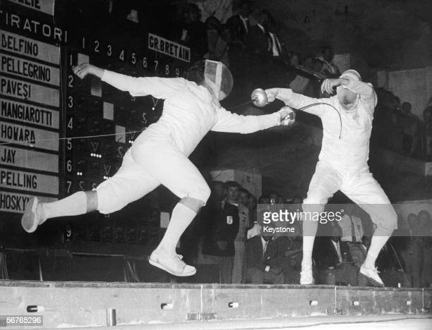 Giuseppe Delfino of Italy scores a winning hit on Allen Jay of Great Britain to take the gold in the Men's Individual Epee at the Rome Olympics 1960