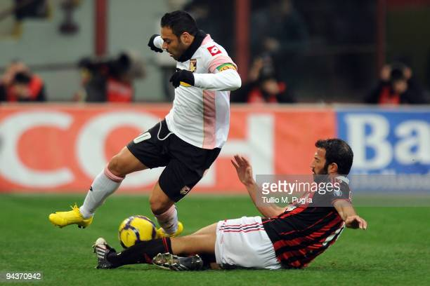 Giuseppe Favalli of Milan and Fabrizio Miccoli of Palermo compete for the ball during the Serie A match between AC Milan and US Citta di Palermo at...