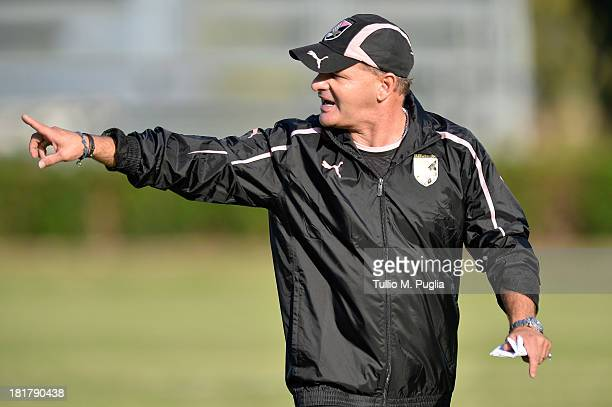 Giuseppe Iachini new coach of Palermo issues instructions during a Palermo training session at Tenente Carmelo Onorato Sports Center on September 25...