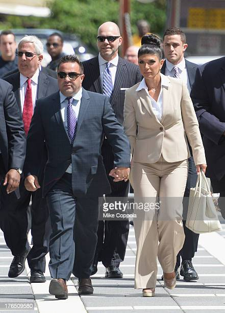 "Giuseppe ""Joe"" Giudice and wife Teresa Giudice appear in court to face charges of defrauding lenders, illegally obtaining mortgages and other loans..."