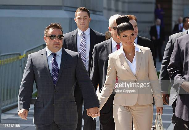 "Giuseppe ""Joe"" Giudice and wife Teresa Giudice leave court after facing charges of defrauding lenders, illegally obtaining mortgages and other loans..."