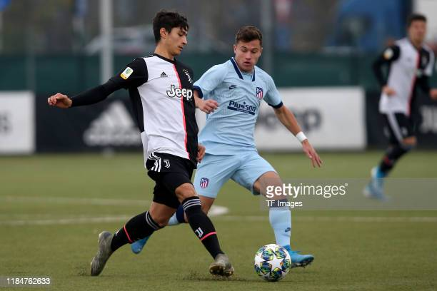 Giuseppe Leone of Juventus Turin U19 and German Valera of Atletico Madrid U19 battle for the ball during the UEFA Youth League match between Juventus...