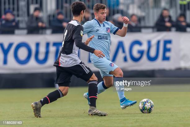 Giuseppe Leone of Juventus U19 and German Valera of Atletico Madrid battle for the ball during the UEFA Youth League match between Juventus U19 and...